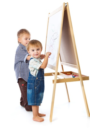 schooltime: Boys are drawing on a blackboard. Isolated on a white background