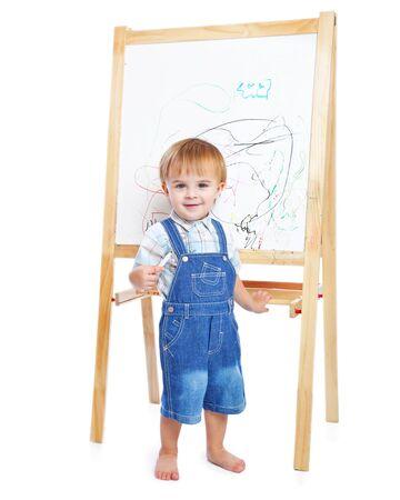 schooltime: A boy is drawing on a blackboard Stock Photo