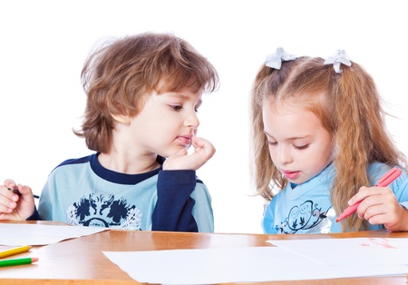Girl and boy are painting. Isolated on white background photo