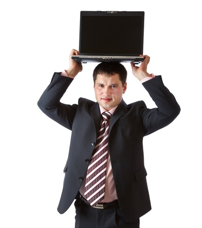 above head: A businessman is holding the laptop above his head. Isolated on a white background