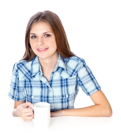 a smiling girl is drinking a coffee from a white cup. isolated on white background photo