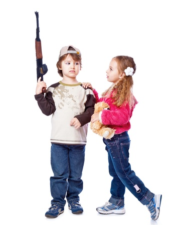perpetrator: A girl is kissing a boy with the gun. Isolated on a white background Stock Photo