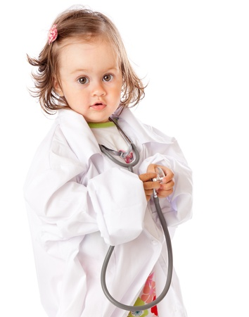doctor toys: A little girl is playing as a doctor. Isolated on a white background