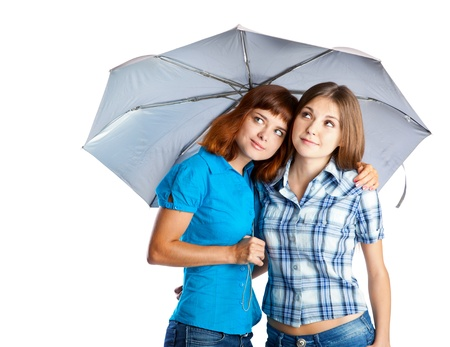 Two teen-girls with umbrella. Isolated on white background photo