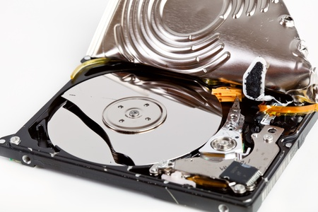 Broken hard disk drive on gray background photo
