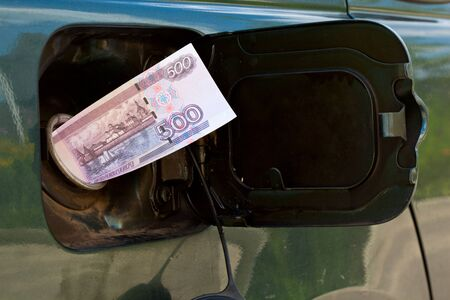 roubles: Banknote of 500 roubles is in petrol tank