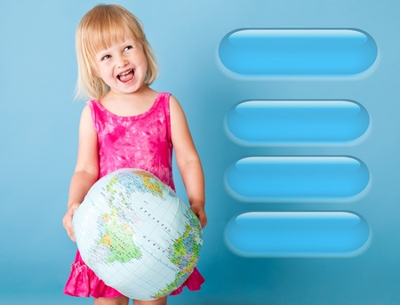 A girl with the globe is choosing. Blue background photo