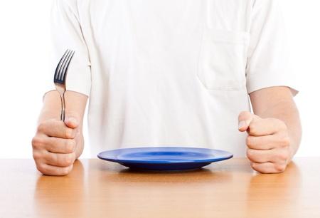 hambriento: Un hombre est� a la espera para una cena. Aislado en un fondo blanco