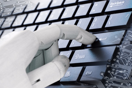 A wooden hand is typing close-up Stock Photo - 10658928