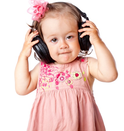 Little girl with headphones. Isolated on white background photo