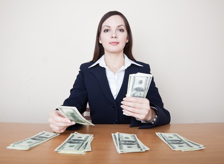 Young business woman with dollars photo