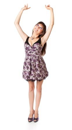Young woman is putting her hands up. Isolated on white background Stock Photo - 11269888