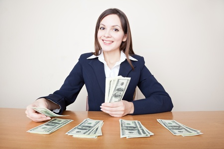 cash desk: Young business woman with dollars Stock Photo