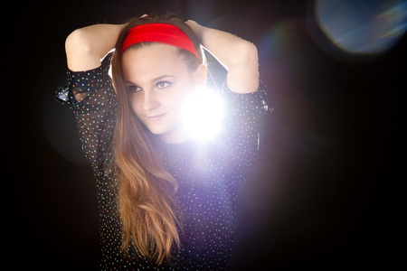 long red hair woman: Young teenager girl on black background