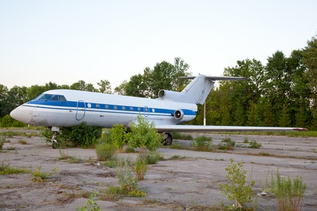 Old russian airplane YAK-40 is on the disused airfield
