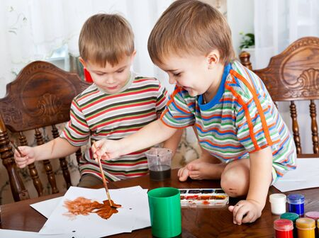 Cute boys are painting something Stock Photo - 12454455