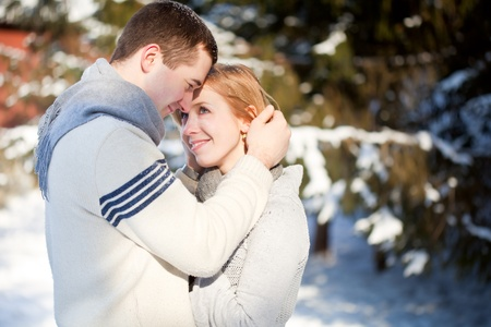 winter wedding: The young couple is loving