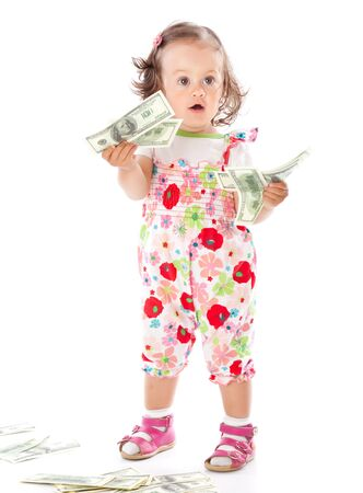 A little girl with money. Isolated on a white background photo