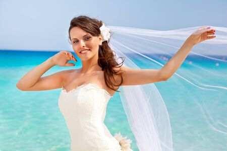 Young brunette bride and the blue sea photo