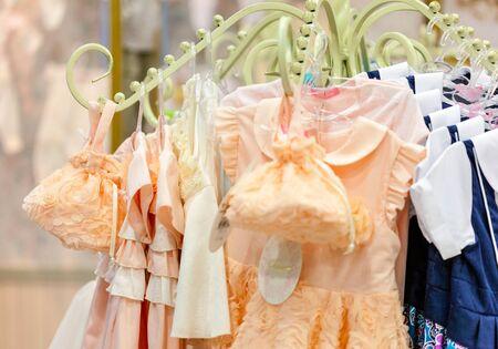 boutique shop: A child shop. Different clothes are closeup