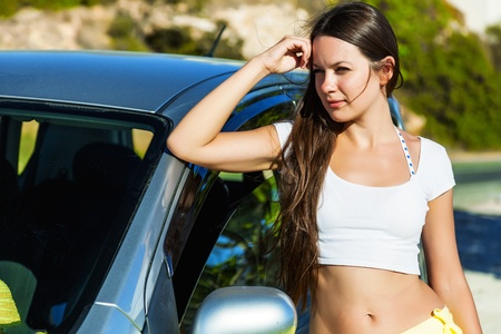 fem: a young woman is near the car