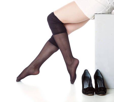 Beautiful legs in black stockings photo