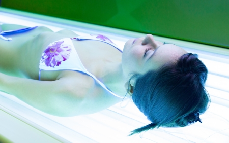 Slim young woman in a solarium Stock Photo - 17903466