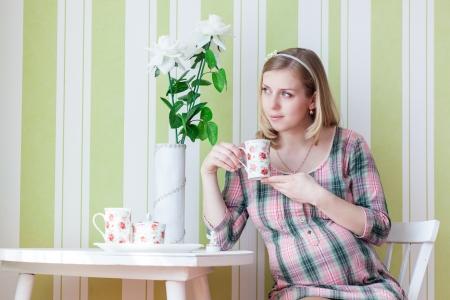 woman drinking tea: Pregnant woman is drinking tea Stock Photo