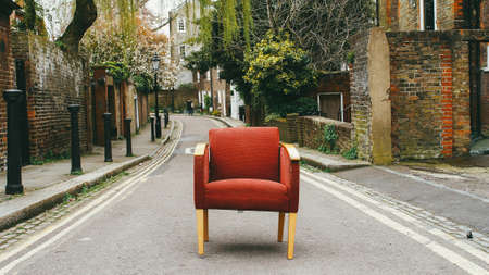 A red chair on a road looking perfect