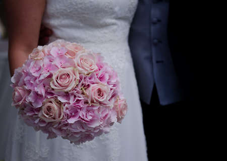 wedding flower holding by a wife looking good Фото со стока