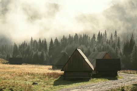 foggy: Huts along the trail in the Tatra Mountains on a foggy morning Stock Photo