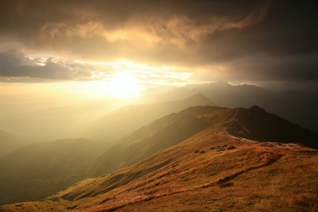storm clouds: Sunrise over the mountains in the Tatras
