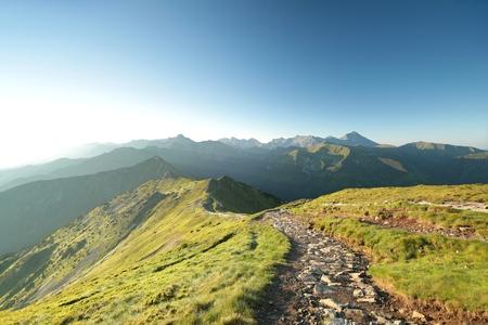 Trail leading through the peaks at sunrise. Tatra Mountains, Poland Stock fotó