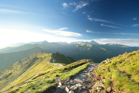 Trail among the peaks in the Tatra Mountains during sunrise