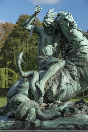 Sculpture of an American Indian on horseback battling with a snake, sculptor Thomas Brock. Rosenburg Castle Gardens, Copenhagen, Denmark Stock Photo