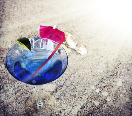 copys pace: Beach background with copys pace, beach sand summer theme, cocktail glass with umbrella and a straw over sand texture Stock Photo