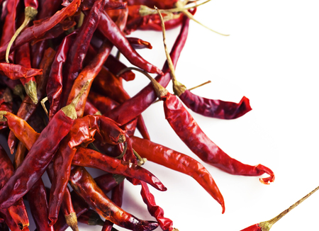 cope: Red hot chili peppers on white background. Spicy pepper. Food photography with cope space. Shallow depth of field, selective focus Stock Photo