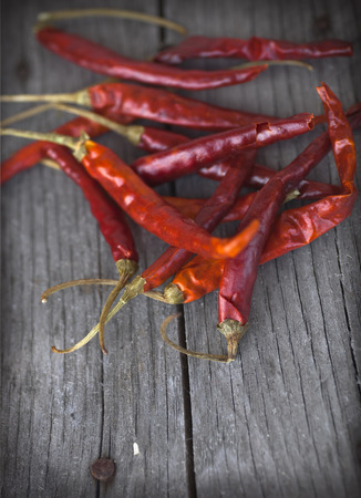 cope: Red hot chili peppers on an old wooden table texture. Spicy pepper. Food photography with cope space. Shallow depth of field, selective focus Stock Photo