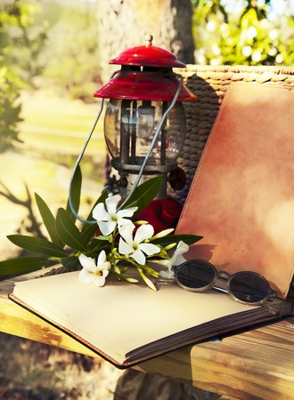 Summer background. red retro Lantern, old book, photo