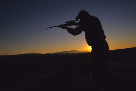 Hunter With Rifle in Sunrise