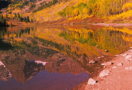 Reflection of Maroon Bells in Lake photo