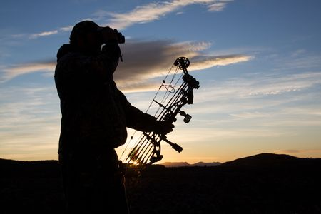 Bowhunter Glassing in Sunrise