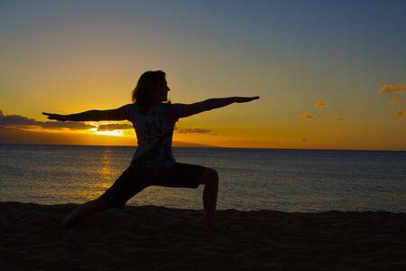 Warrior Yoga Pose at Sunset photo