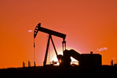 Oil Drilling Rig in Sunset