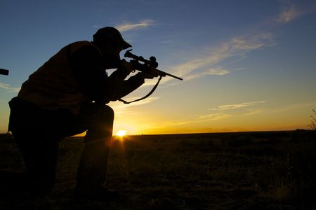 caza: Hunter de fusil en Sunset