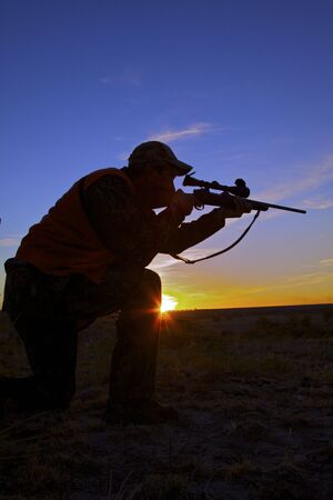 deer hunting: Rifle Hunter in Sunset Stock Photo