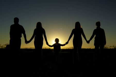 Family Holing Hands in unity