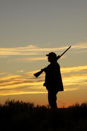 cazador: Hunter en la puesta de sol Foto de archivo