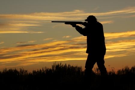 Hunter Shooting at Sunset