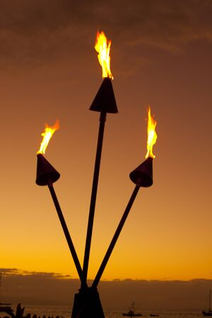 Tiki Torches at Sunset